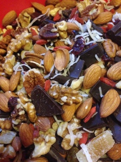 Walnuts, pecans, dark chocolate chunks, cranberries, goji berries, coconut flakes, and dried mango.